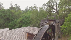 Aerial of Bale Grist Mill with large water wheel Stock Footage