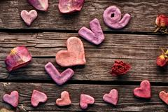Word Love with rose petals and small heart - stock photo