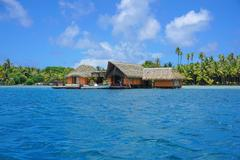 Tropical home over water French Polynesia - stock photo