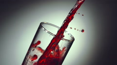 Cherry juice is poured into a glass Stock Footage