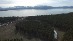 4K aerial drone shot South Lake tahoe above pine trees Arkistovideo