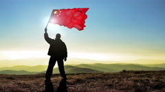 Successful silhouette man winner waving China flag on top of the mountain Stock Footage