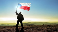 Successful silhouette man winner waving Czech Republic flag on top of the mou Stock Footage