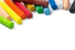 Spectrum of colorful crayons Stock Photos