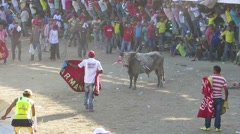 Bull stands in front of the crowd of people Stock Footage