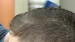 Getting The Hair Cut - stock footage