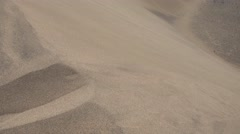 Detail Of Sand In Wind Running Down A Dune In The Desert - stock footage