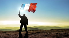 Successful silhouette man winner waving France flag on top of the mountain pe Stock Footage