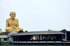 Biggest statue of Luang Pu Thuat - stock photo