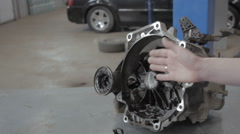 Engineer Hands Fixing Engine Power Transmission Gears Box - stock footage
