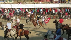 Bull rushes on arena chased by riders with spears Stock Footage