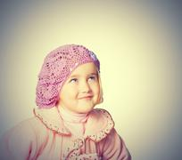 Little girl in a pink coat and beret - stock photo