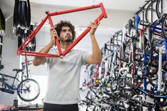 Worker repairing bicycles Stock Photos