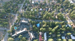 4K Aerial drone shot over houses trees to lake Arkistovideo