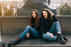 Two young adult girls - stock photo