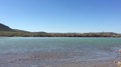 The Ili River.Kazakhstan.Beautifulwater and stones. Stock Footage