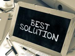 Best Solution Handwritten by White Chalk on a Blackboard - stock illustration