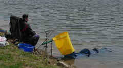 Fisherman on the lake, feeder fishing  by Pakito. Stock Footage