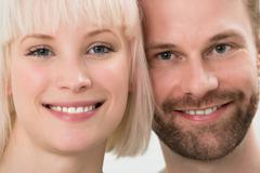 Close-up Photo Of Toothy Smiling Young Couple - stock photo