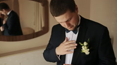 Groom preparing for the wedding ceremony Stock Footage