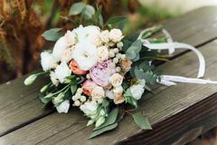 Bridal bouquet of roses on a  wooden planks Stock Photos