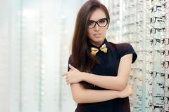 Elegant Bowtie Woman with Cat Eye Frame Glasses in Optical Store - stock photo