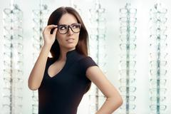 Young Woman with Eyeglasses in Optical Store - stock photo
