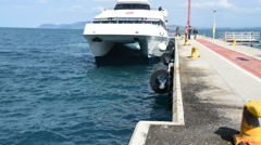 A ferry docks to drop off and load up passengers Stock Footage