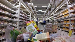 Buying products in the hypermarket. Buying meat, eggs and products. Stock Footage