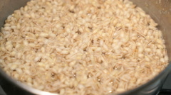 Barley porridge cooked in the pan Stock Footage