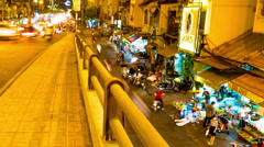 Panning and zooming view at the Roadside market at night in Ho Chi Minh City Stock Footage