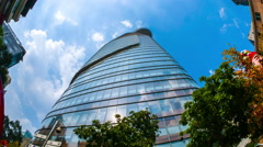 Panning and zooming view of skyline over Bitexco Financial Tower Stock Footage