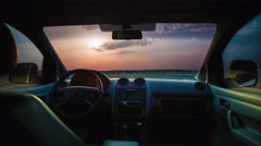 The flow of cloud against the sunset. Inside car view. Time lapse Stock Footage