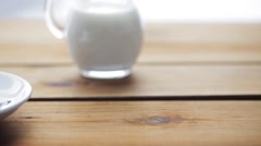 Full cup of coffee on wooden table Stock Footage