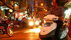 Zoom out view of the night street in the Ho Chi Minh City Stock Footage