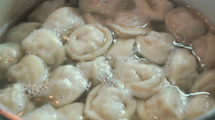Homemade ravioli is cooked  in the boiling water Stock Footage