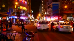 Static view of the night street in the Ho Chi Minh City Stock Footage