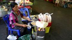 Thai woman toasting Roti Bread Stock Footage