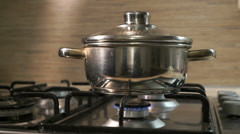 Stainless steel pot on the stove with a gas burner - stock footage