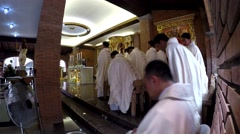 Priests stand during holy mass congregation - stock footage