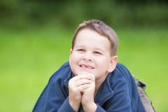 Stock Photo of little boy with a torn front first milk tooth