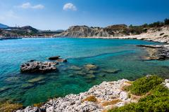 Kolymbia beach with the rocky coast in Greece. - stock photo