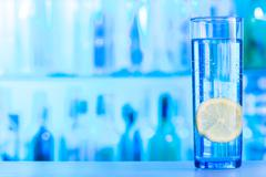 Refreshing glass of mineral water with lemon Stock Photos