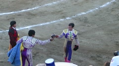 Matador runs around the arena enjoying applause of the public - stock footage