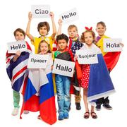 Kids greeting each other in different languages - stock photo