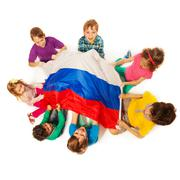 Kids around the flag of Russian Federation - stock photo