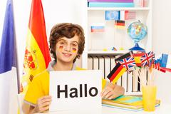 Schoolboy learning German at the light classroom - stock photo