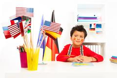 Spanish boy learning geography sitting at the desk - stock photo
