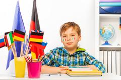 Italian schoolboy on geography lesson in classroom - stock photo