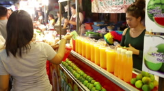 Fruit juice stand woman serve drinks Thailand Stock Footage